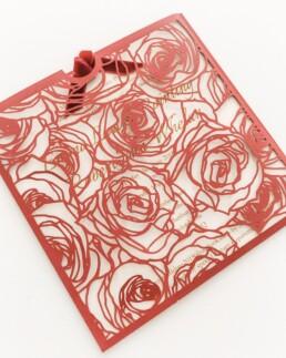 Laser-cut pocket wedding invitations: La vie en rose