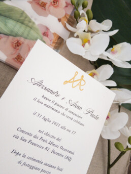 Banana leaf and orchid invitations and stationery